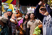 Oct 14, 2008 -- PHOENIX, AZ: People on the midway with stuffed animals play a basketball game at the Arizona State Fair. The Arizona State Fair started Oct.  10 and runs through Nov. 2. Carnival and midway workers who have worked the fair for years say attendance so far is much lower than in the past and people at the fair this year aren't spending as much money as they have in the past. Photo by Jack Kurtz / ZUMA Press