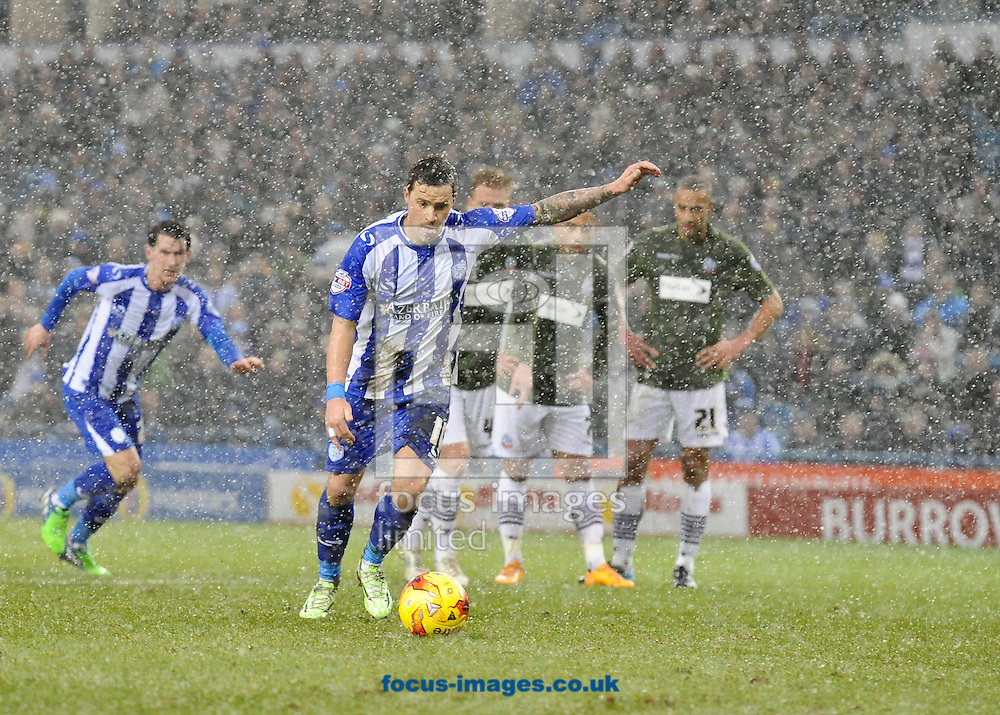 Chris Maguire of Sheffield Wednesday scores from the penalty spot in the sleet and snow to make it 2-1 during the Sky Bet Championship match at Hillsborough, Sheffield<br /> Picture by Richard Land/Focus Images Ltd +44 7713 507003<br /> 17/01/2015
