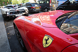 © Licensed to London News Pictures. 27/07/2015. London, UK. A Ferrari supercar with Saudi Arabian license plates seen near Park Lane in London. Kensington and Chelsea Borough Council have announced plans that will make it a criminal offence to cause excessive noise unnecessarily, which will aim to stop showboating by drivers revving their engines, or super-fast accelerating. Photo credit : James Gourley/LNP