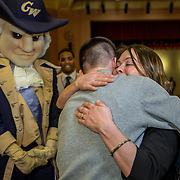 WASHINGTON,DC - MAR18: Mario Velasquez, a senior at Benjamin Banneker Academic High School, gets a hug from his mom Doris, after he was surprised at school with a hand-delivered acceptance letter and full scholarship to attend George Washington University, March 18, 2015, through the Stephen Joel Trachtenberg Scholarship program. (Photo by Evelyn Hockstein/For The Washington Post)