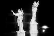 Caserta, Italia - 27 novembre 2009. Due imponenti statue del Cristo lungo la strada provinciale che porta a Giulgliano. E' frequente notare iconografie religiose nei luoghi della camorra. I Carabinieri del nucleo operativo di castello di Cisterna hanno arrestato 33 persone legate ai clan camorristici che operano nel casertano. Tra gli arrestati spiccano i nomi di Antonio e Marcello Marrazzo dell'omonimo clan.<br /> Ph. Roberto Salomone Ag. Controluce<br /> ITALY, Caserta - Holy iconograph is typical to be foun in mafia areas. Carabinieri arrested 33 people linked to neapolitan mafia organisation on November 27, 2009.
