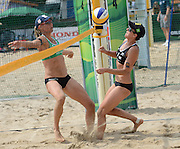 STARE JABLONKI POLAND - July 5: Barbara Hansel and Stefanie Schwaiger /L/of Austria in action during Day 5 of the FIVB Beach Volleyball World Championships on July 5, 2013 in Stare Jablonki Poland.  (Photo by Piotr Hawalej)