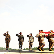 The remains of U.S. Marine Corps Lance Corporal Jeremy S. Lasher, of Oneida, N.Y. are carried during a Dignified Transfer ceremony on Saturday, July 25, 2009 at Dover AFB in Dover, Delaware.  Lasher was killed July 23, 2009 in the Helmand province of Afghanistan during combat operations supporting Operation Enduring Freedom.