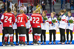 20.02.2014, Bolshoy Ice Dome, Adler, RUS, Sochi, 2014, Eishockey Damen, Medaillenfeier, im Bild Das Schweizer Team mit der Bronze Medaille an der Medaillenfeier gratuliert den Kanadierinnen // during Womens Icehockey Medal Ceremony of the Olympic Winter Games Sochi 2014 at the Bolshoy Ice Dome in Adler, Russia on 2014/02/20. EXPA Pictures © 2014, PhotoCredit: EXPA/ Freshfocus/ Urs Lindt<br /> <br /> *****ATTENTION - for AUT, SLO, CRO, SRB, BIH, MAZ only*****