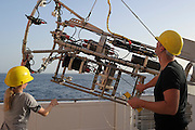 Henk-Jan Hoving and Svenja Christiansen are preparing the videosystem PELAGIOS. The PELAGIOS is a towed ocean observation instrument that consists of an aluminium frame with a forward looking HD video camera and LED lights. Underwater surveys with optical techniques like PELAGIOS, ROVs and plankton recorders have revealed fauna that are not sampled by nets, and show a diverse fauna of gelatinous organisms in the mesoand bathypelagic zones. During MSM49 PELAGIOS was used to investigate the impact of different oceanographic features on the vertical distribution, abundance and diversity of macrozooplankton and (micro)nekton. Atlantic Ocean, close to Cape Verde | Atlantischer Ozean, nahe Kap Verde