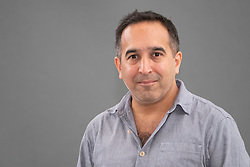 """Edinburgh, Scotland, UK; 17 August, 2018. Pictured; Sam Guglani a clinical oncologist. Sam has set his book of linked stories  """" Histories"""" in a hospital, helping him explore the human need for genuine communications."""