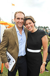 KATE SILVERTON and her fiancé MIKE HERRON at the 2009 Veuve Clicquot Gold Cup Polo final at Cowdray Park Polo Club, Midhurst, West Sussex on 19th July 2009.