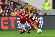 Kasey Palmer (45) of Bristol City goes down from a foul by Romain Saiss (27) of Wolverhampton Wanderers during the The FA Cup 5th round match between Bristol City and Wolverhampton Wanderers at Ashton Gate, Bristol, England on 17 February 2019.