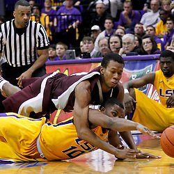 February 14, 2012; Baton Rouge, LA; LSU Tigers guard Andre Stringer (10) and Mississippi State Bulldogs guard Rodney Hood (4) scramble for a loose ball during the second half of a game at the Pete Maravich Assembly Center. LSU defeated Mississippi State in overtime 69-67. Mandatory Credit: Derick E. Hingle-US PRESSWIRE