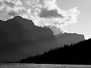 Backlit mountains and St. Mary Lake in a monochrome study of Glacier National Park
