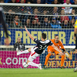 Falkirk's Owain Tudor Jones scores and own goal past keeper Jamie MacDonald. Falkirk 1 v 3 Rangers, Scottish League Cup game played 23/9/2014 at The Falkirk Stadium.