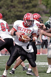 09 September 2006 Comet quarterback Calvin McNamara works in the pocket..In the first ever football competition between the Olivet Comets and the Illinois Wesleyan Titans, the Titans strut off the field with a 21- 6 victory. .Game action took place at Wilder Field on the campus of Illinois Wesleyan University in Bloomington Illinois.