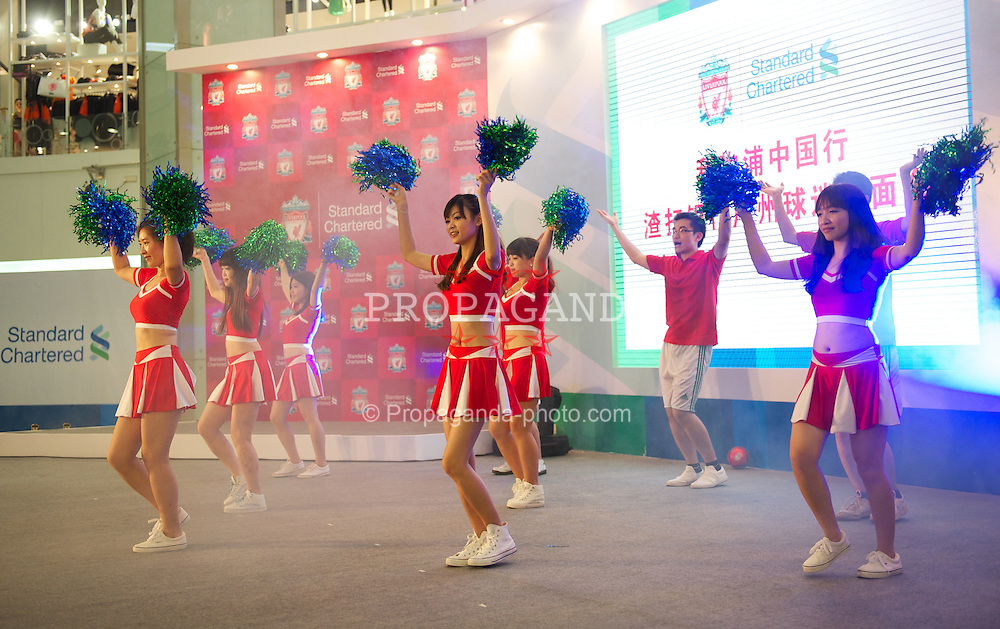 GUANGZHOU, CHINA - Tuesday, July 12, 2011: Cheerleaders during a promotional event for Standard Charter at the Tianhe Shopping Center during day two of the club's Asia Tour. (Photo by David Rawcliffe/Propaganda)