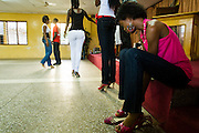 Matilda Mikekpor, 23, puts on her heels upon arriving at rehearsal where models come to practice their catwalk in Ghana's capital Accra on Thursday May 21, 2009. Matilda is one of several Ghanaian girls who auditioned for the upcoming television show West Africa's Next Top Model, the latest incarnation of Tyra Banks' America's Next Top Model.