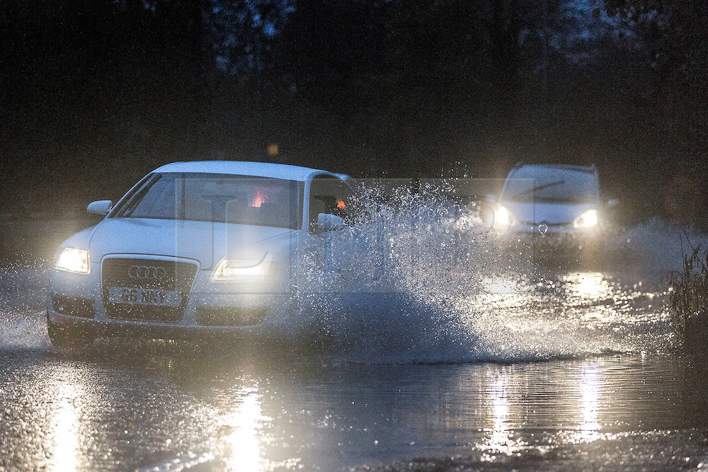 © Licensed to London News Pictures. 15/11/2015. Ilkley, UK. Cars struggle through flooded roads around Ilkley this morning as the county suffered another night of heavy rain. Photo credit: Andrew McCaren/LNP