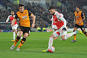 Olivier Giroud of Arsenal FC (12) and Hull City defender Harry Maguire (12) during the The FA Cup fifth round match between Hull City and Arsenal at the KC Stadium, Kingston upon Hull, England on 8 March 2016. Photo by Ian Lyall.