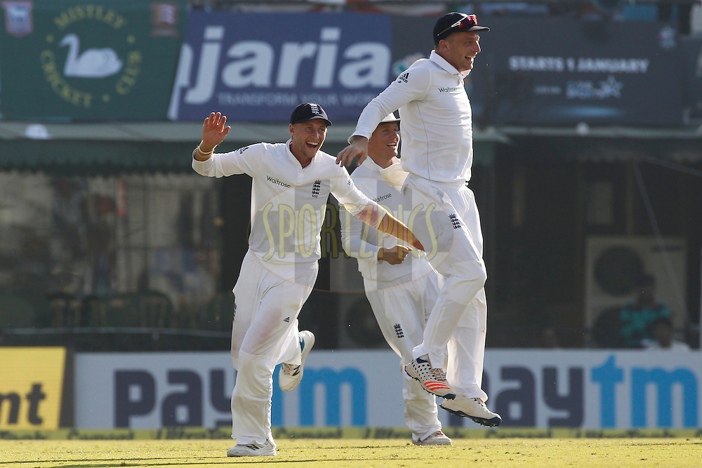 Jos Buttler of England and Joe Root of England celebrates the wicket of Karun Nair of India during day 2 of the third test match between India and England held at the Punjab Cricket Association IS Bindra Stadium, Mohali on the 27th November 2016.<br /> <br /> Photo by: Deepak Malik/ BCCI/ SPORTZPICS
