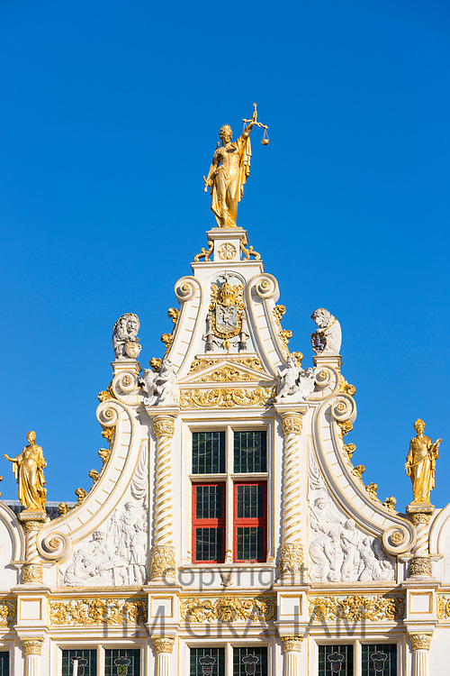 Gold leaf Lady Justice - Justitia - statue with scales of justice at Court of Justice Courthouse Registry in Bruges, Belgium
