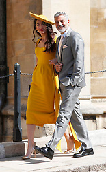 Amal Clooney and George Clooney arrive for the wedding ceremony of Prince Harry and Meghan Markle at St. George's Chapel in Windsor Castle.