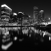 Boston Black and white photography of the famous Boston skyline. This unique New England city of Boston night scenery photograph is available as museum quality photography prints, canvas prints, acrylic prints or metal prints. Fine art prints may be framed and matted to the individual liking and decorating needs:<br />