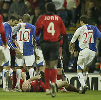 Photo: Aidan Ellis.<br /> Blackburn Rovers v Bayer Leverkusen. UEFA Cup, 2nd Leg. 22/02/2007.<br /> Rovers Zurab Khizanishvili (L) tells Bayer's Sergej Barbarez to get up after he fakes that he has been punched by a Rovers player