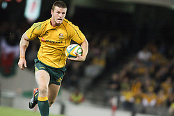 © Licensed to London News Pictures. 16/06/2012. Etihad Stadium, Melbourne Australia. Wallaby Rob Horne runs with the ball towards the try line during the 2nd Rugby Test between Australia Wallabies Vs Wales . Photo credit : Asanka Brendon Ratnayake/LNP