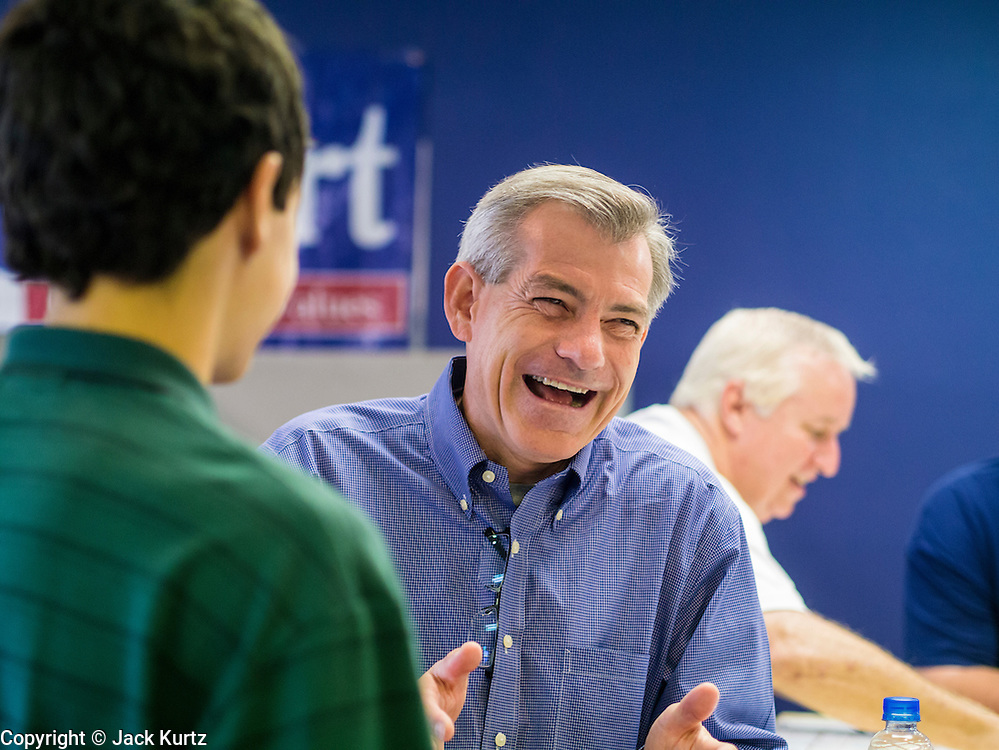 02 JUNE 2012 - PHOENIX, AZ:  Congressman DAVID SCHWEIKERT (R-AZ) laughs while talking to campaign volunteers Saturday. Schweikert met with his campaign staff and volunteers for a pancake breakfast Saturday morning at the campaign headquarters to talk to them about the upcoming primary election against fellow Republican Ben Quayle. Republican incumbents Schweikert and Quayle will face each other in Arizona's Aug. 28 primary election. Redistricting because of the census has thrown the two conservative freshman Republican Congressmen into Arizona's 6th Congressional District. The district is made up of mostly upper middle class neighborhoods in north Phoenix and the wealthy suburban communities of Scottsdale, Fountain Hills and Cave Creek. The District is strongly Republican and whoever wins the Republican primary is expected to easily win November's general election.       PHOTO BY JACK KURTZ