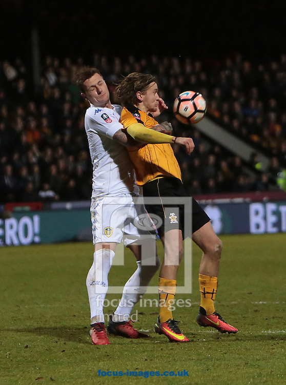 Luke Berry of Cambridge United and Liam Cooper of Leeds United during the FA Cup match at the Cambs Glass Stadium , Cambridge<br /> Picture by Glenn Sparkes/Focus Images Ltd 07939664067<br /> 09/01/2017