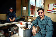 ANP officers (Afghan National Police) are posing for a portrait in their booth along Bamiyanís new bazaar. The cliff where once stood the Western Buddha (55m - 'Male') is photographed after sunset in Bamiyan, Afghanistan, an area mostly populated by Hazaras. The Buddhas of Bamiyan were two 6th century monumental statues of standing Buddhas carved into the side of a cliff in the Bamiyan valley in the Hazarajat region of central Afghanistan, situated 230 km northwest of Kabul at an altitude of 2500 meters. The statues represented the classic blended style of Gandhara art. The main bodies were hewn directly from the sandstone cliffs, but details were modelled in mud mixed with straw, coated with stucco. Amid widespread international condemnation, the smaller statues (55 and 39 meters respectively) were intentionally dynamited and destroyed in 2001 by the Taliban because they believed them to be un-Islamic idols. Once a stopping point along the Silk Road between China and the Middle East, researchers think Bamiyan was the site of monasteries housing as many as 5,000 monks during its peak as a Buddhist centre in the 6th and 7th centuries. It is now a UNESCO Heritage Site since 2003. Archaeologists from various countries across the world have been engaged in preservation, general maintenance around the site and renovation. Professor Tarzi, a notable An Afghan-born archaeologist from France, and a teacher in Strasbourg University, has been searching for a legendary 300m Sleeping Buddha statue in various sites between the original standing ones, as documented in the old account of a renowned Chinese scholar, Xuanzang, visiting the area in the 7th century. Professor Tarzi worked on projects to restore the other Bamiyan Buddhas in the late 1970s and has spent most of his career researching the existence of the missing giant Buddha in the valley.