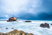 Severe winters storm lashing the southern tip of Africa's coastline with a shipe wreck in the foreground, Agulhas National Park, Western Cape, South Africa