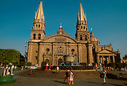 MEXICO, MAJOR CITIES Guadalajara; the Cathedral c.1558-1616, west facade seen across fountains in Plaza de los Laureles.