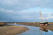 Yacht moored on mud at Blakeney Estuary in Norfolk, UK