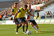 Oxford United defender Phil Edwards (16) and Bradford City midfielder Nicky Law (4) battle for possession 0-0 during the EFL Sky Bet League 1 match between Oxford United and Bradford City at the Kassam Stadium, Oxford, England on 15 October 2016. Photo by Alan Franklin.