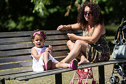 © Licensed to London News Pictures. 22/07/2014. London, UK. Anushka (aged 2) and her mother enjoying a picnic in the sunshine in Regents Park in central London this lunchtime. Photo credit : Vickie Flores/LNP