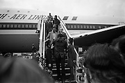 Muhammad Ali In Dublin..1972..11.07.1972..07.11.1972..11th July 1972..Prior to his fight against Al 'Blue' Lewis at Croke Park ,Dublin, former World Heavyweight Champion,Muhammad Ali arrives at Dublin Airport..The fight was part of his build up for for a championship fight against the current World Champion, 'Smokin'  Joe Frazier. Ali had been stripped of the title partly due to his refusal to join the American military during The Vietnam War,which he had opposed...Image of Muhammad Ali as he takes the time to chat with two Aer Lingus hostesses.