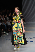 OCTOBER 18: A model presents the Tokuko 1er vol collection at the Amazon Fashion Week Tokyo's 2017 Spring/Summer show under way at Shibuya Hikarie in Tokyo on Oct. 18, 2016. and other locations through 23rd. Tokuko 1er vol's Japanese designer Tokuko Maeda launched the brand in 1989. Nearly 50 fashion brands and companies will hold their shows at several locations through 23rd.. 18/10/2016-Tokyo, JAPAN