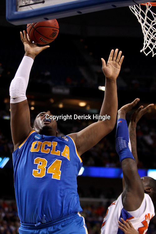Mar 19, 2011; Tampa, FL, USA; UCLA Bruins center Joshua Smith (34) shoots against the Florida Gators during second half of the third round of the 2011 NCAA men's basketball tournament at the St. Pete Times Forum. Florida defeated UCLA 73-65.  Mandatory Credit: Derick E. Hingle
