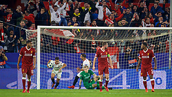 SEVILLE, SPAIN - Tuesday, November 21, 2017: Liverpool's goalkeeper Loris Karius looks dejected as Sevilla score a second goal from a penalty kick, but the referee orders a re-take, Sevilla score the re-taken penalty, during the UEFA Champions League Group E match between Sevilla FC and Liverpool FC at the Estadio Ramón Sánchez Pizjuán. (Pic by David Rawcliffe/Propaganda)
