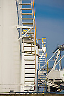Stairs on side of oil and gas tanks at Port of Seattle, Harbor Island