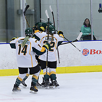 4th year defender Nikki Watters-Matthes (14) of the Regina Cougars joins in on the celebration after the Cougars take a 2 - 0 lead in the 2nd period their home opener on October 7 at Co-operators arena. Credit: Arthur Ward/Arthur Images