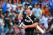 Wicket - Jimmy Neesham of New Zealand looks up as the big screen and looks annoyed about his dismissal as he walks back to the pavilion after being dismissed by during the ICC Cricket World Cup 2019 Final match between New Zealand and England at Lord's Cricket Ground, St John's Wood, United Kingdom on 14 July 2019.