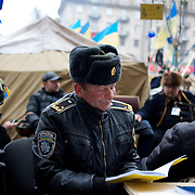 December 19, 2013 - Kiev, Ukraine: Pro-EU demonstrators sit beside a barricade on a road leading to Independence Square.<br /> On the night of 21 November 2013, a wave of demonstrations and civil unrest began in Ukraine, when spontaneous protests erupted in the capital of Kiev as a response to the government's suspension of the preparations for signing an association and free trade agreement with the European Union. Anti-government protesters occupied Independence Square, also known as Maidan, demanding the resignation of President Viktor Yanukovych and accusing him of refusing the planned trade and political pact with the EU in favor of closer ties with Russia.<br /> After a days of demonstrations, an increasing number of people joined the protests. As a responses to a police crackdown on November 30, half a million people took the square. The protests are ongoing despite a heavy police presence in the city, regular sub-zero temperatures, and snow. (Paulo Nunes dos Santos/Polaris)