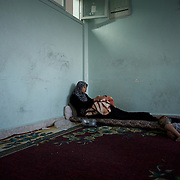 August 11, 2012 - Azaz, Aleppo, Syria: A syrian war refugee lays with her one day old son, Mohamad, in a improvised refugee center in Azaz, where 32 families who fled the combat areas are temporarily living. (Paulo Nunes dos Santos)