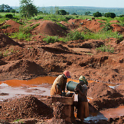 Artisenal gold miners work at a local mine outside of Geita.