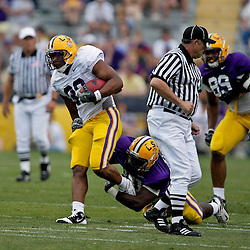 18 April 2009: LSU running back Charles Scott (32) evades a tackle by defensive end Chancey Aghayere (81) during the 2009 LSU spring football game at Tiger Stadium in Baton Rouge, LA.