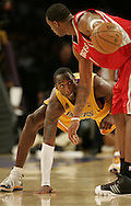 Kobe Bryant slaps the floor while defending Houston's Tracy McGrady during the Lakers' 2007 home opener.