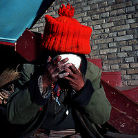 "MEILI MOUNTAIN, DECEMBER 17, 2000: a Tibetan nomad eats Tsampa at Feilai monastery near Mt. Meili in the morning in deqin county, Yunnan province , December 17, 2000..Mt. Meili is the highest peak in Yunnan province and according to supporters from Deqin county, it's a ""proof"" that the 'real"" Shangri-La is located in deqin county. The fictuous Mt. Karakal which is described in James Hilton's Lost Horizon, alledgedly is modelled on Mt. Meili in Yunnan province.."