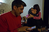 A Syrian family interacts around the dinner table in their room at Refanidis hotel.<br />