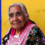 She was sitting outside on a chair infront of her house in Coyacan, Mexico. Her inner harmony captivated me, so I asked for permission to take this phot.