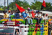 "10 JANUARY 2007 - MANAGUA, NICARAGUA: Sandanista supporters from the Nicaraguan countryside roll into Managua to witness the inauguration of Daniel Ortega. Ortega, the leader of the Sandanista Front, was sworn in as the President of Nicaragua Wednesday. Ortega and the Sandanistas ruled Nicaragua from their victory of ""Tacho"" Somoza in 1979 until their defeat by Violetta Chamorro in the 1990 election.  Photo by Jack Kurtz"